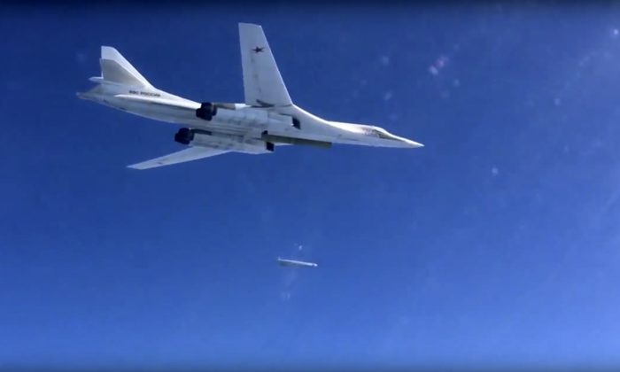 A Russian air force Tu-160 bomber launches a cruise missile on a target in Syria on Nov. 20, 2015. (AP Photo)