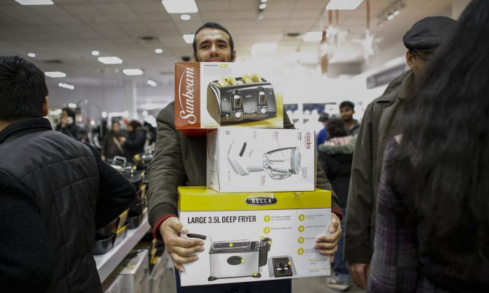 A man shop at the JCPenney store at the Newport Mall on Thanksgiving day in Jersey City, N.J., on  on Nov. 27, 2014. (Kena Betancur/Getty Images)