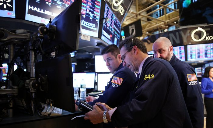 Traders work on the floor of the New York Stock Exchange at the end of the trading day in New York City on Feb. 3, 2014. The global economy is facing new threats it is unable to defend against. (Spencer Platt/Getty Images)