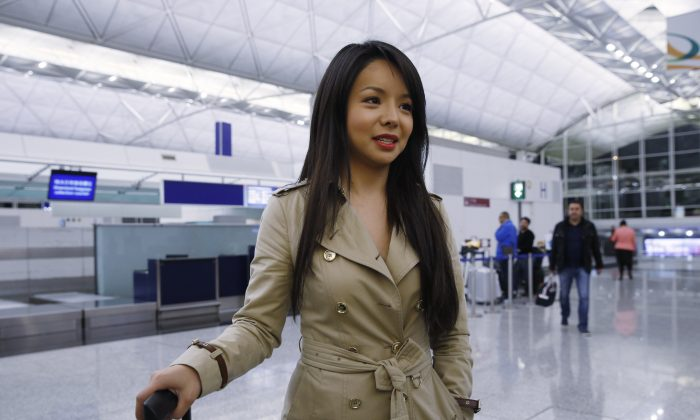 Canada's Miss World contestant Anastasia Lin speaks to media after she was denied entry to mainland China, at Hong Kong International Airport in Hong Kong on Nov. 26, 2015. (AP Photo/Kin Cheung)