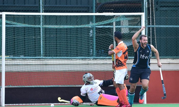 Tom Moore of HKFC-A celebrates scoring the opening goal against SSSC-A in the HKHA premier division at the Hong Kong Football Club ground on Sunday Nov 22, 2015. (Cox/Epoch Times)
