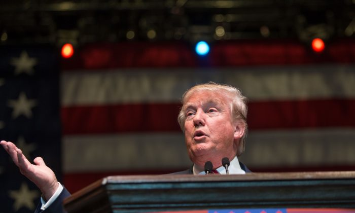 Republican presidential candidate Donald Trump speaks during a campaign rally at the Macon Centreplex, Monday, Nov. 30, 2015, in Macon, Ga. (AP Photo/Branden Camp)