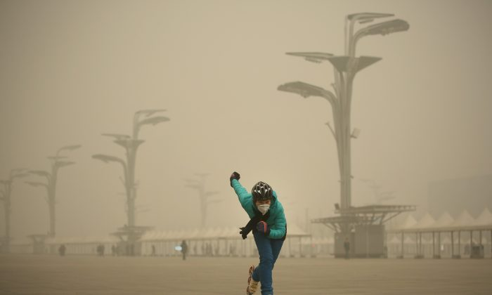 A woman wearing a mask practices roller blading at Olympic Park during heavy smog  in Beijing, China, on Dec. 1, 2015. (Li Feng/Getty Images)