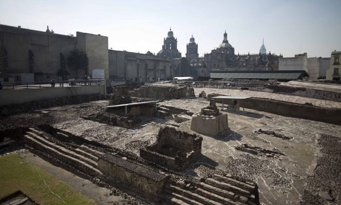 Tourists visit the Templo Mayor archaeological site in Mexico City, Tuesday Dec. 1, 2015. Mexican archaeologists have discovered at the archaeological site a long tunnel leading into the center of a circular platform where Aztec rulers were believed to be cremated. The Aztecs are believed to have cremated the remains of their leaders during their 1325-1521 rule, but the final resting place of the cremains has never been found. (AP Photo/Eduardo Verdugo)