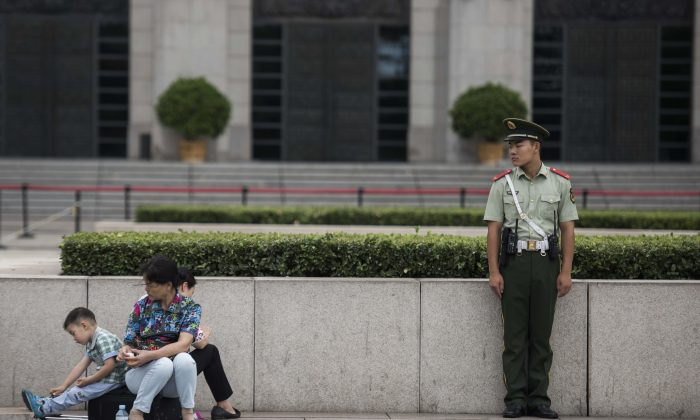 A Chinese paramilitary guard in Tiananmen Square on Sept. 1, 2015. (Fred Dufour/AFP/Getty Images)