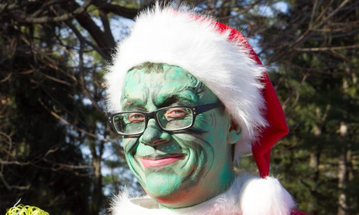 Jim Hendry dressed as the Grinch in the Rick Drew Holiday Parade in Port Jervis on Dec. 6, 2015. (Holly Kellum/Epoch Times)