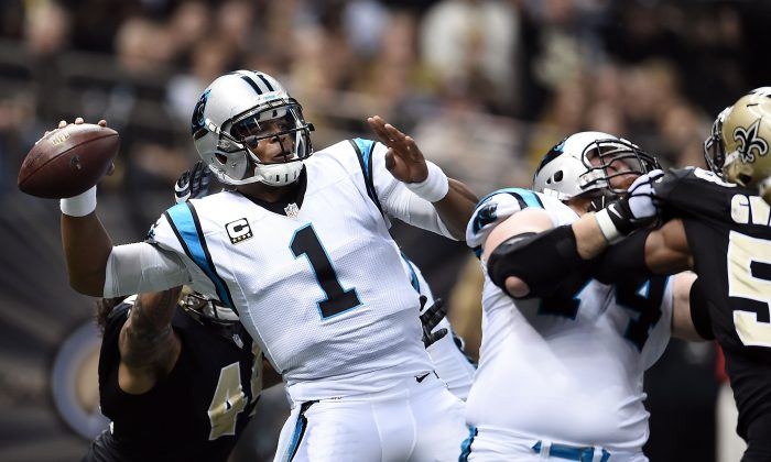 Cam Newton drops back to pass against the New Orleans Saints at the Mercedes-Benz Superdome on Dec. 6 in New Orleans. The Carolina quarterback took a big step toward NFL MVP honors with his performance. (Stacy Revere/Getty Images)