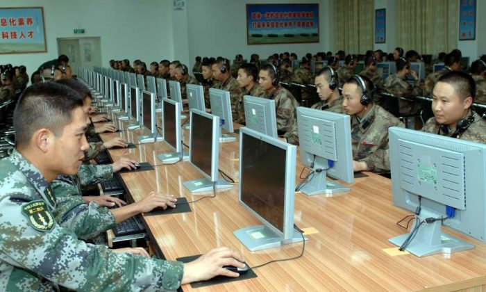 Chinese soldiers work at computers. Cyberattacks from China have continued despite agreements from the CCP to stop.(mil.huanqiu.com)