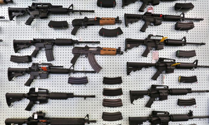 In this July 20, 2014, file photo, guns are displayed for sale at Dragonman's, an arms seller east of Colorado Springs, Colo. (AP Photo/Brennan Linsley)