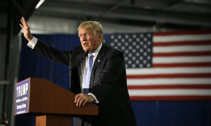 Republican presidential candidate Donald Trump speaks during a campaign rally, Saturday, Dec. 5, 2015, in Davenport, Iowa. (AP Photo/Charlie Neibergall)