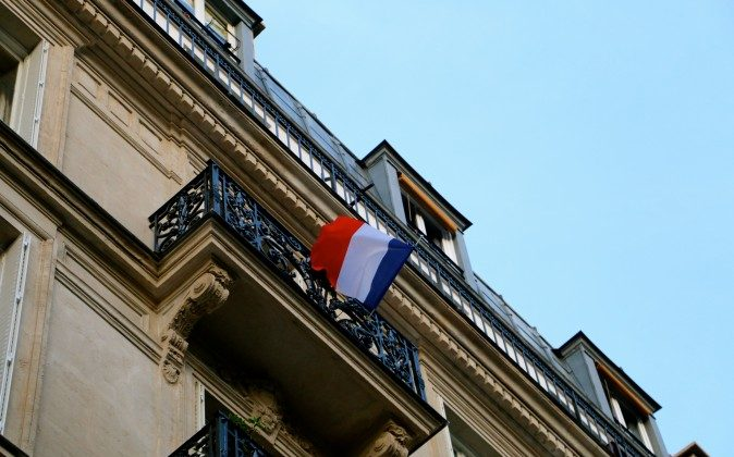 Many Parisians have displayed the French flag as a sign of national unity. (Nolan Peterson/The Daily Signal)