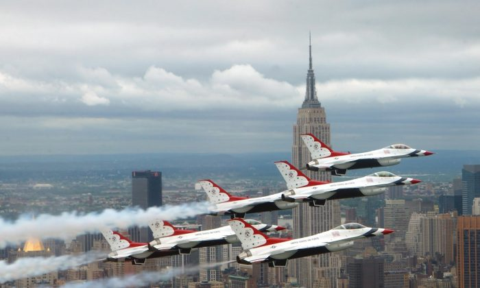NEW YORK -- Six F-16 Fighting Falcons with the U.S. Air Force Thunderbirds aerial demonstration team fly in delta formation in front of the Empire State Building during an air show May 26.  (U.S. Air Force photo by Tech. Sgt. Sean Mateo White)