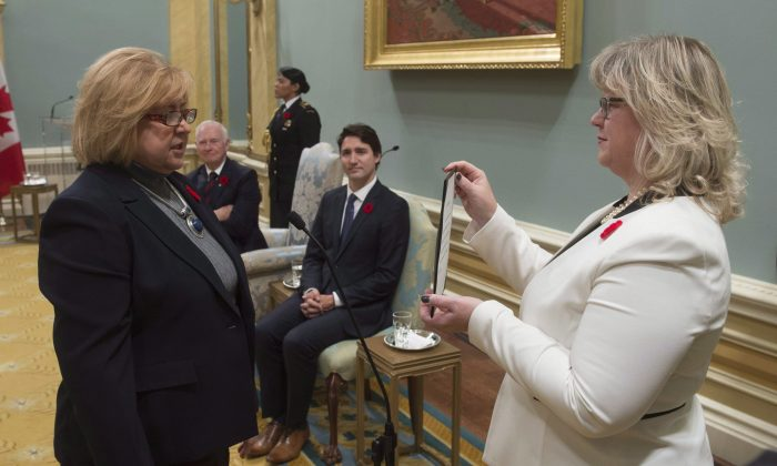 Labour Minister MaryAnn Mihychuk is sworn in at Rideau Hall on Nov.4, 2015, in Ottawa. Mihychuk is overhauling the EI system and labour code to address a growing gap between current regulations and disruptive new business models. (THE CANADIAN PRESS/Adrian Wyld)