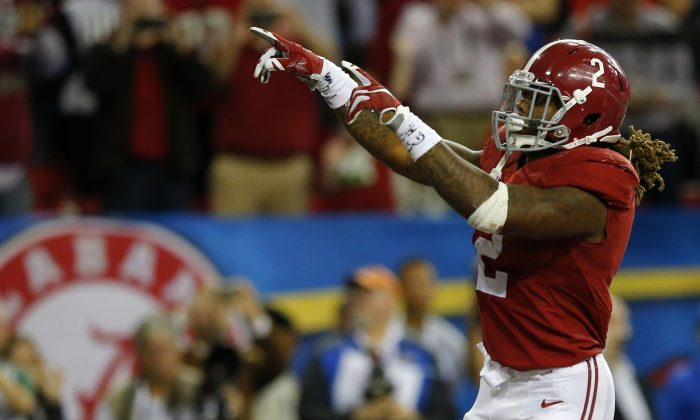 Running back Derrick Henry of the Alabama Crimson Tide set an SEC record with 1,986 rushing yards this season. (Kevin C. Cox/Getty Images)