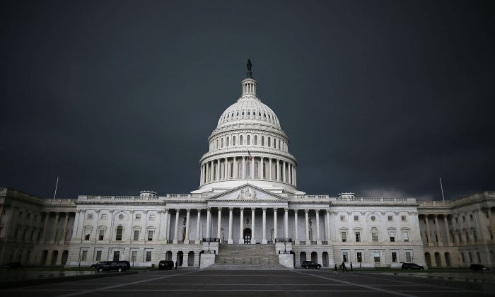 Storm clouds fill the sky over the U.S. Capitol Building in Washington, D.C., on June 13, 2013. (Mark Wilson/Getty Images)