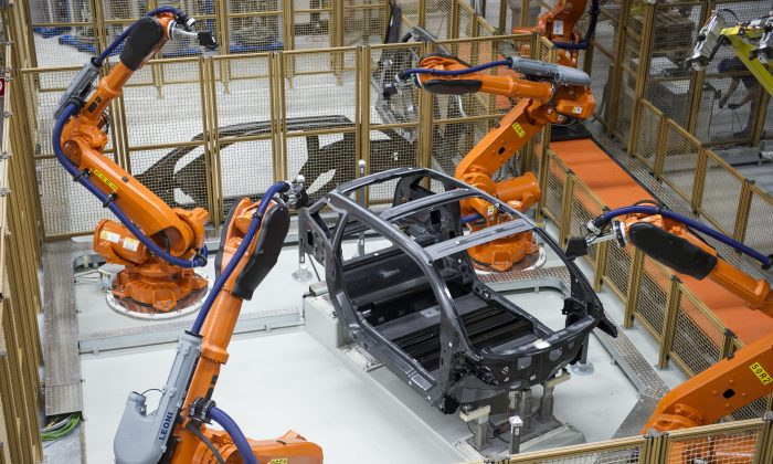 Robots manufacture a carbon chassis of a new BMW i3 electric car on the assembly line at the BMW factory on September 18, 2013 in Leipzig, Germany. (Jens Schlueter/Getty Images)