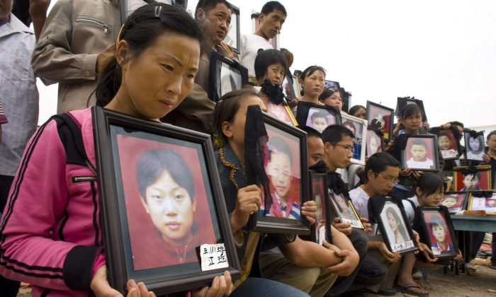 Parents mourn their children, who died at Fuxin Primary School on May 22, 2008, in Wufu, Sichuan Province, China, on May 22, 2015. (Paula Bronstein/Getty Images)