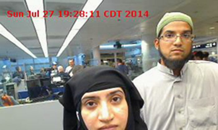 This July 27, 2014 file photo provided by U.S. Customs and Border Protection shows Tashfeen Malik, left, and Syed Farook, as they passed through O'Hare International Airport in Chicago. (U.S. Customs and Border Protection via AP, File)