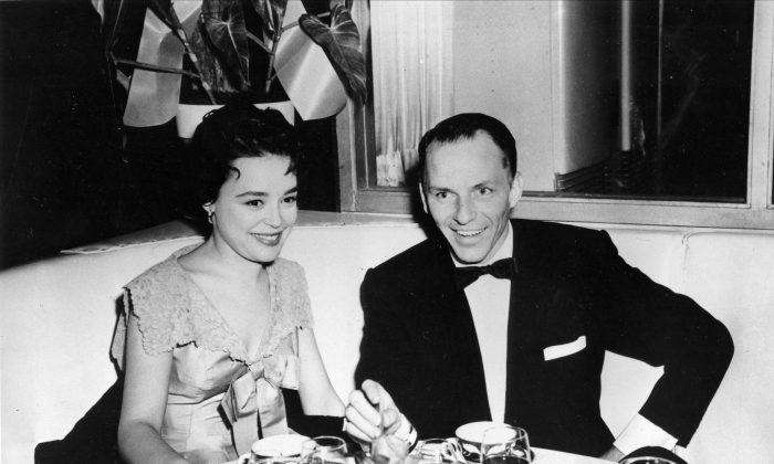 In this 1954 file photo, Frank Sinatra sits with recording artist Jill Corey at the Harwyn Club in New York.  (AP Photo, File)