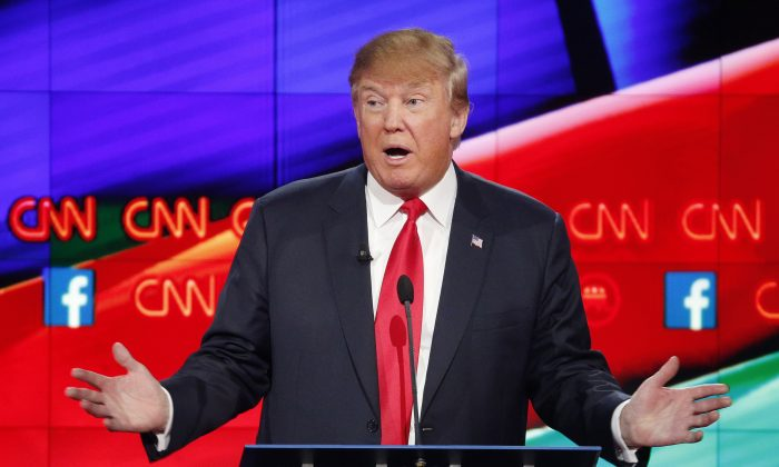 Donald Trump makes a point during the CNN Republican presidential debate at the Venetian Hotel & Casino on Tuesday, Dec. 15, 2015, in Las Vegas. (AP Photo/John Locher)