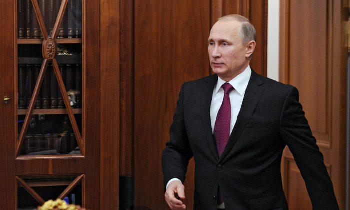 Russian President Vladimir Putin enters a hall for meeting with human rights ombudswoman Ella Pamfilova in the Kremlin in Moscow, Russia, Thursday, Dec. 10, 2015. (Mikhail Klimentyev/Sputnik, Kremlin Pool Photo via AP)