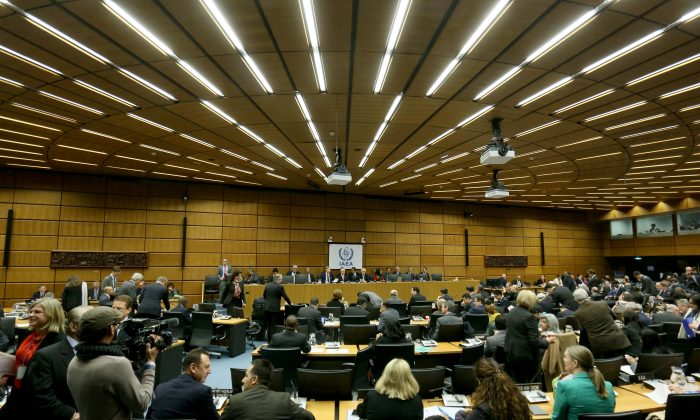 Delegates wait for the start of the board of governors meeting of the International Atomic Energy Agency (IAEA) at the International Center in Vienna, Austria, Tuesday, Dec, 15, 2015. The U.N. nuclear agency is set to close the books on a decade-long probe of allegations that Iran worked on atomic arms. (AP Photo/Ronald Zak)