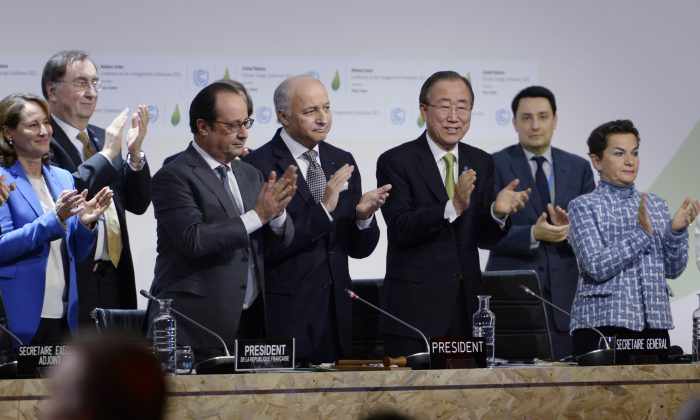 French Ecology Minister Segolene Royal (L), French President Francois Hollande (2ndL), French Foreign Minister Laurent Fabius (C) and United Nations Secretary General Ban Ki-moon (2ndR) applaud after a statement at the COP21 Climate Conference in Le Bourget, north of Paris, on Dec. 12, 2015.  (Miguel Medina/AFP/Getty Images)