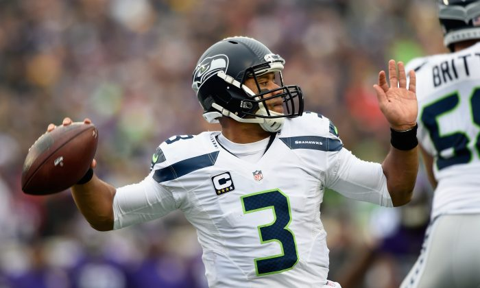 Russell Wilson has at least three TD passes—and no interceptions—in each of the past four games for the Seattle Seahawks. (Hannah Foslien/Getty Images)