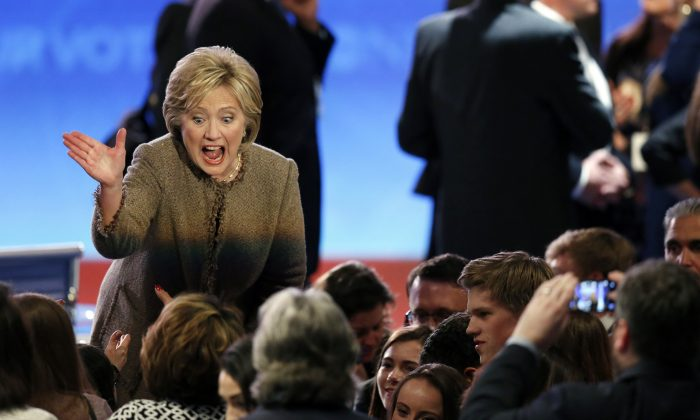 Hillary Clinton greets supporters after a Democratic presidential primary debate Saturday, Dec. 19, 2015, at Saint Anselm College in Manchester, N.H. (AP Photo/Jim Cole)