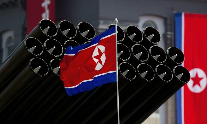 A North Korean flag before missiles at a military parade to mark 100 years since the birth of the country's founder Kim Il-Sung in Pyongyang on April 15, 2012. (Ed Jones/AFP/Getty Images)