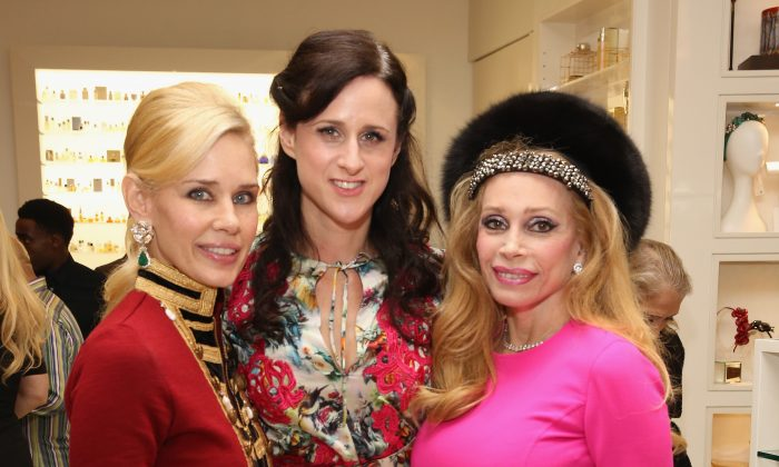 (L-R) Michelle-Marie Heinemann, CEO and publisher of Old Fashioned Mom Magazine, Tanja Dreiding Wallace of Osswald Parfumerie and Joy Marks attend a shopping extravaganza benefiting The Children's Home of Poughkeepsie in New York City on Dec. 10, 2015. (Robin Marchant/Getty Images for Old Fashioned Mom Magazine)