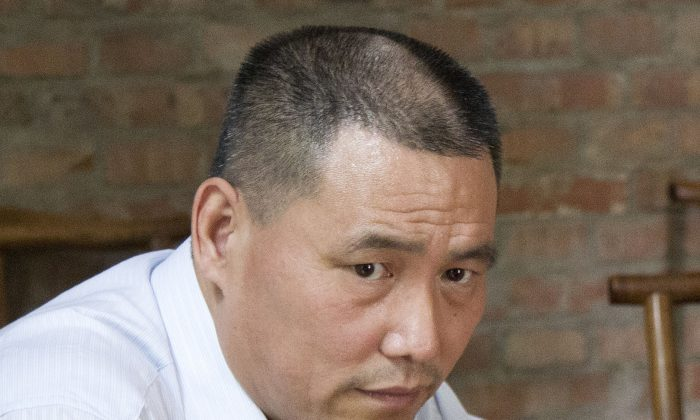 Human rights lawyer Pu Zhiqiang in Beijing on June 20, 2012. (AP Photo/Andy Wong)