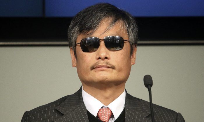 """Chen Guangcheng, visiting fellow at Catholic University of America, speaks at a forum on """"The Deteriorating State of Human Rights in China,"""" at the Cato Institute, on Nov. 23, 2015. Chen is a blind legal advocate and activist who is best known for exposing the abuses of China's population planning officials, including forced abortions and sterilizations. (Gary Feuerberg/Epoch Times)"""