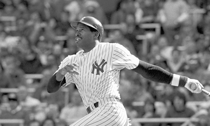Dave Winfield of the New York Yankees watches his two run homer sail out of Yankee Stadium in the fifth inning of game with the Toronto Blue Jays on Sunday, April 17, 1983 in New York. The homer proved to be the game winning RBI in the Yanks 7-5 win. (AP Photo/Ray Stubblebine)