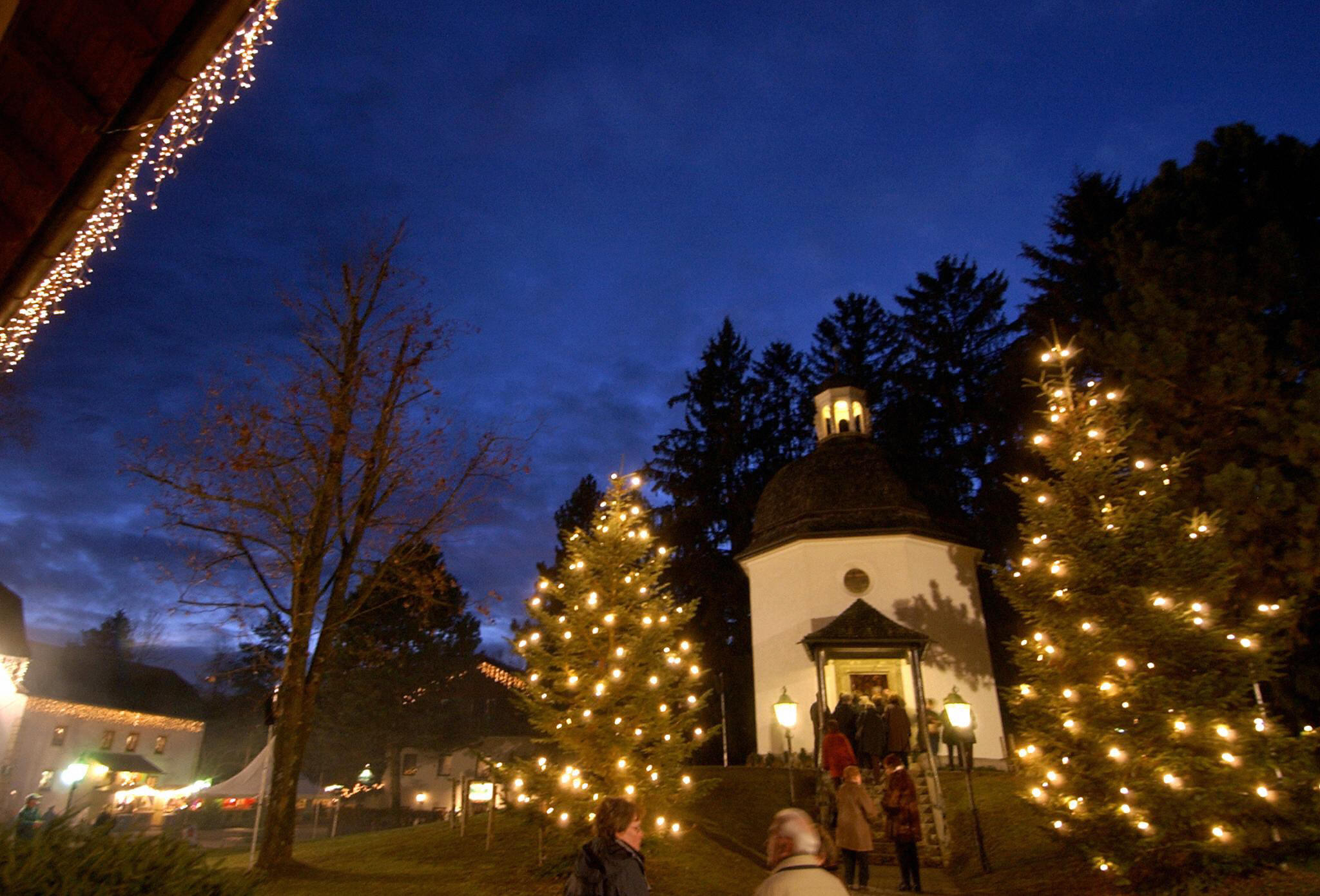 tourists visit the silent night memorial chapel in the austrian village of oberndorf on dec - Costco Open Christmas Eve