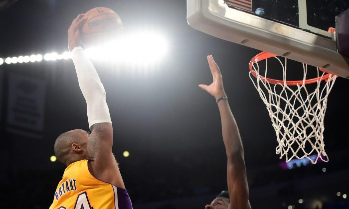 Lakers star Kobe Bryant has scored better than 20 points in four straight games. (Harry How/Getty Images)