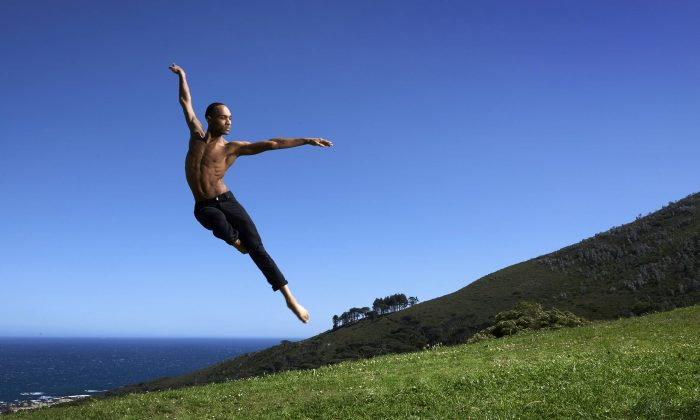 Alvin Ailey American Dance Theater's Sean Aaron Carmon on on Muizenberg Beach in Cape Town. (Andrew Eccles)