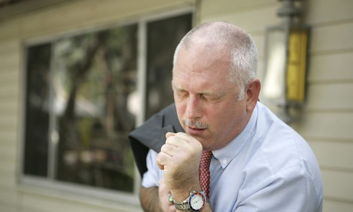 Coughing helps expel toxins for people with COPD. (lisafx/iStock)