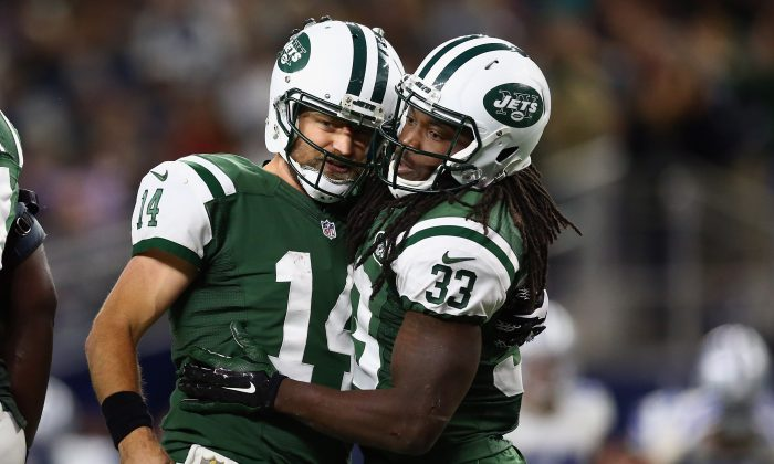 Ryan Fitzpatrick (L) has yet to return to Buffalo since being released following the 2012 season. (Ronald Martinez/Getty Images)