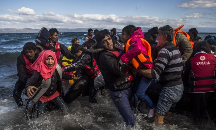 Afghan migrants disembark safely from their frail boat on the Greek island of Lesbos after crossing the Aegean sea from Turkey on Oct. 28, 2015. Greece's government says it is preparing a rent-assistance program to cope with a growing number of refugees, who face the oncoming winter and mounting resistance in Europe. (AP Photo/Santi Palacios)