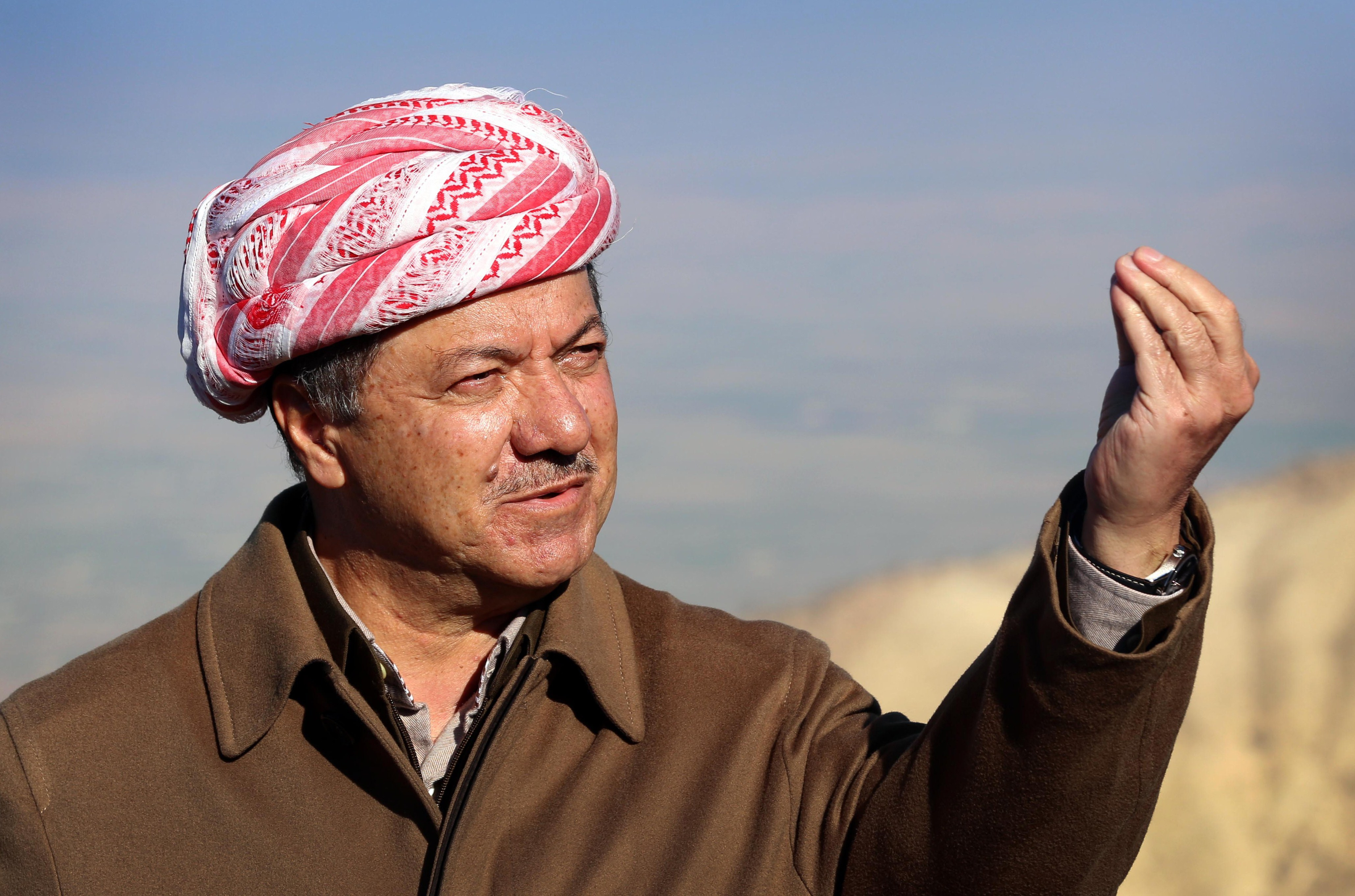 Iraqi Kurdish leader Masoud Barzani speaks to journalists on Dec. 21, 2014, during a visit to Mount Sinjar, west of the northern Iraqi city of Mosul. (Safin Hamed/AFP/Getty Images)