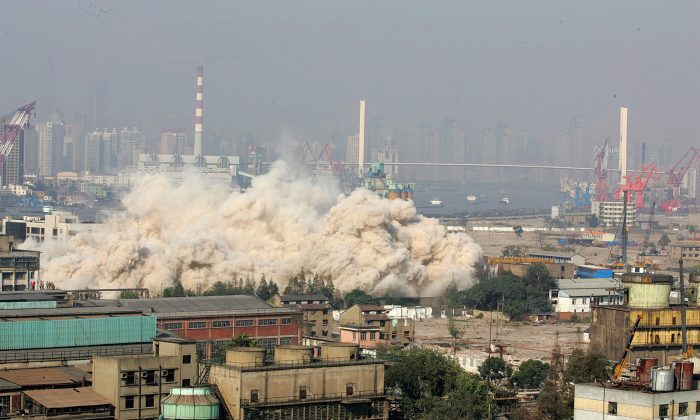 Explosives are used to demolish the highest building in the Shanghai World Expo site to make way for construction work for the 2010 Shanghai World Expo in Shanghai, China, on Nov. 8, 2006. (China Photos/Getty Images)