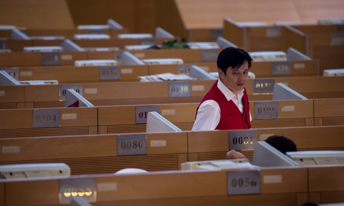 A man works on the trading floor at the Shanghai Stock Exchange  on September 22, 2015. (JOHANNES EISELE/AFP/Getty Images)
