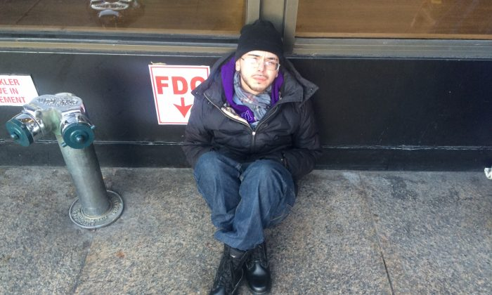 Anthony Gonsalez, 29, homeless for 2 years, sits in the cold near Penn Station in New York.