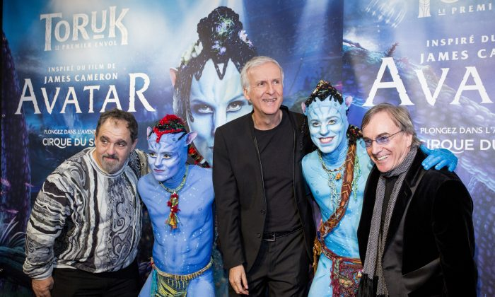"""Avatar"" producer Jon Landau, director James Cameron, Cirque du Soleil president Daniel Lamarre with Entu and Ralu, characters from ""Toruk – The First Flight"" at the world premiere in Montreal, December 21, 2015.  (Courtesy Cirque du Soleil)"