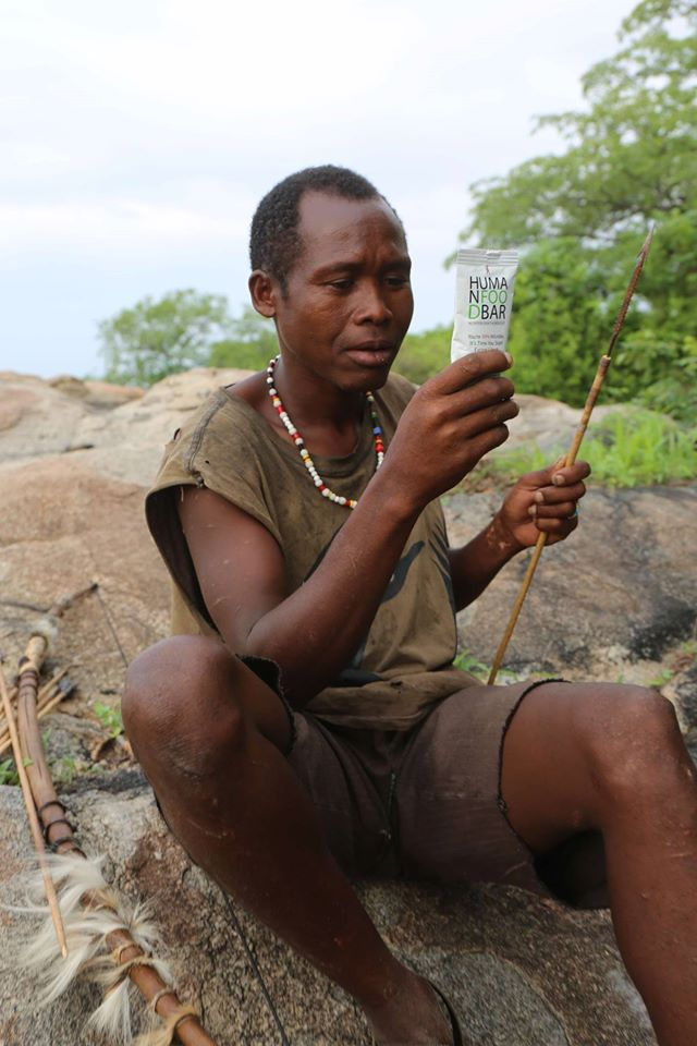 A Hadza hunter-gatherer studies the ingredient label on Human Food Bar, a product co-founded by Jeff Leach of the Human Food Project. (www.humanfoodbar.com)
