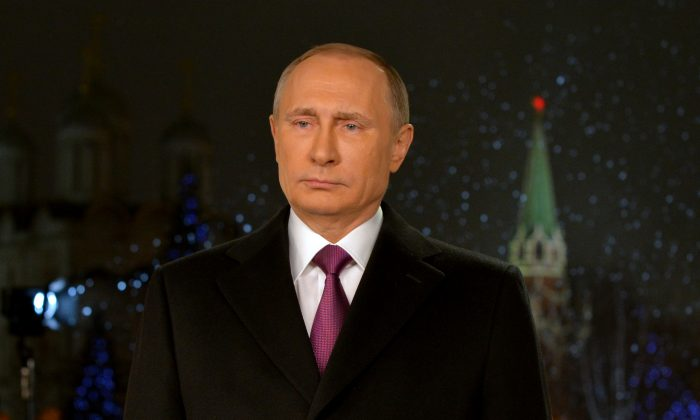 Russia's President Vladimir Putin makes his New Year's address to the nation in Moscow's Kremlin, on Dec. 31, 2015. (Alexey Druzhinin/AFP/Getty Images)