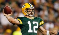 Aaron Rodgers Carted Off Field to Locker Room