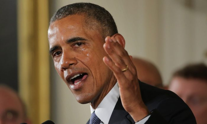 With tears running down his cheeks, President Barack Obama talks about the victims of the 2012 Sandy Hook Elementary School shooting and about his efforts to increase federal gun control in the East Room of the White House in Washington, D.C., on Jan. 5, 2016. Without approval from Congress, Obama is sidestepping the legislative process with executive actions to expand background checks for some firearm purchases and step up federal enforcement of existing gun laws. (Chip Somodevilla/Getty Images)