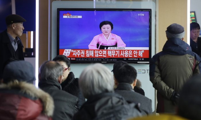 People watch a TV news program showing North Korea's announcement, at the Seoul Railway Station in Seoul, South Korea, on Jan. 6, 2016. (AP Photo/Ahn Young-joon)